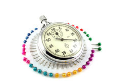 Scatter pins and Stop-watch Stock Photo