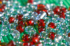 The scattered beads of red and gray color Stock Image