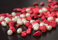 The scattered beads of red and white color Royalty Free Stock Images
