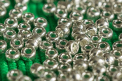 The scattered beads of silvery color Stock Image
