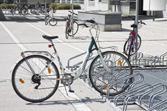Scattered bikes parked in the Street Royalty Free Stock Images