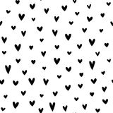 Scattered black hearts on white background Royalty Free Stock Images
