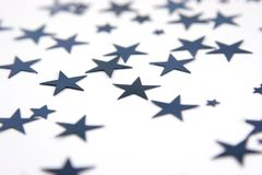 Scattered blue stars. With selective focus isolated over white Stock Photo