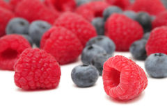Scattered blueberry and raspberry on white background Royalty Free Stock Photo