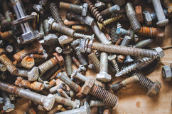 Scattered bolts as a background Stock Photos