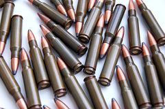 Scattered bullets. Overhead view of bullet scattered on white background Stock Image
