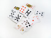 Scattered Cards. Random playing cards scattered over a white background royalty free stock images