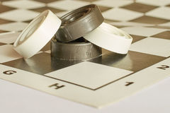 Scattered checkers on chess Board. Scattered checkers on a chess Board Royalty Free Stock Photos