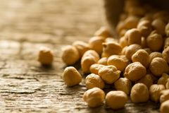 Scattered chickpeas from a jute bag Stock Image