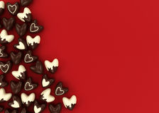 Scattered chocolate candy hearts Royalty Free Stock Photography