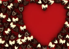 Scattered chocolate candy hearts Stock Image