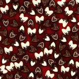 Scattered chocolate candy hearts Stock Photo