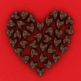 Scattered chocolate candy hearts Royalty Free Stock Images