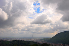 Scattered clouds over the city Royalty Free Stock Images