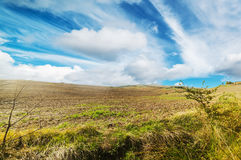 Scattered clouds over Tuscany Stock Photo
