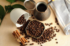 The scattered coffee beans with cinnamon stock photos