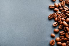 Scattered coffee beans frame design on copy space background stock images