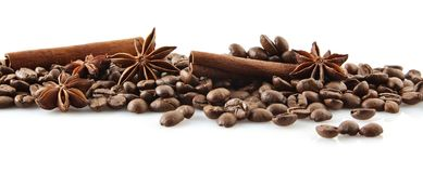 Scattered coffee beans in line on white Stock Image