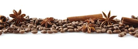 Scattered coffee beans in line on white Stock Images