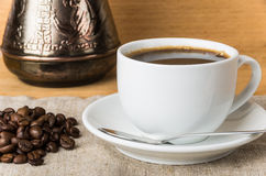 Scattered coffee beans, Turk and glass Cup Stock Photo