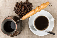 Scattered coffee beans, Turk and glass Cup Stock Images
