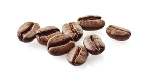Scattered coffee beans on white Stock Images