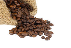 Scattered coffee grains on a white Stock Image