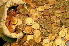 Scattered coins Stock Photos