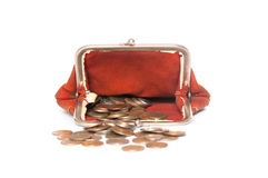 Scattered coins and purse Stock Images