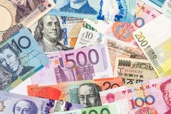 Scattered collection of money. From different countries stock photo