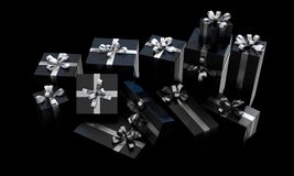 Scattered Gift Box Pile. A scattered collection of various sized gift boxes wrapped in a shiny black paper and a silver ribbon and bow on an isolated dark studio royalty free stock photography