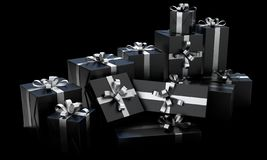Scattered Gift Box Pile. A scattered collection of various sized gift boxes wrapped in a shiny black paper and a silver ribbon and bow on an isolated dark studio stock images