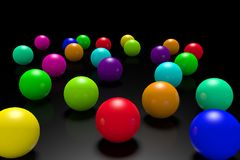 Scattered colored balls on a black background. Royalty Free Stock Photography