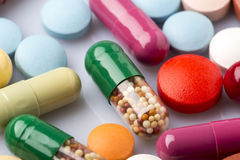 Scattered colorful medical pills and drugs Royalty Free Stock Photos