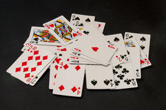 Scattered deck of cards on a black background Royalty Free Stock Photography
