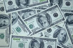 Scattered 100 dollar bills royalty free stock photography