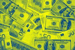 Scattered dollars and euros royalty free stock photo