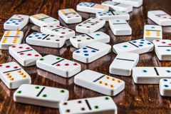 Scattered Dominoes on Wood Background Stock Photo