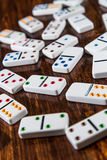 Scattered Dominoes on Wood Background Royalty Free Stock Photo