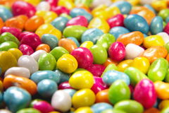 Scattered dragees of different colors. Stock Photography
