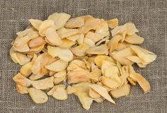 Scattered dried garlic on a background of rough cloth Royalty Free Stock Image