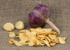 Scattered dried garlic on a background of rough cloth Stock Photo