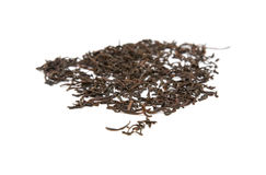Scattered dry black tea leaves Stock Image