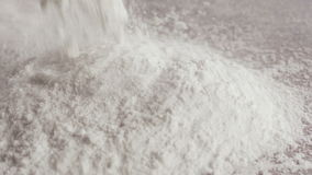 Scattered dry flour on a kitchen counter top stock video