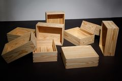 Scattered empty wooden boxes on floor. Stock Photos