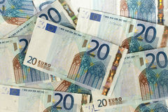 Scattered 20 euro banknotes closeup. Scattered euro currency banknotes closeup Royalty Free Stock Photos