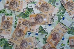 Scattered 100 euro and 200 PLN banknotes. Polish and European currency. Scattered 100 euro and 200 PLN banknotes - background. Polish and European currency Royalty Free Stock Photos