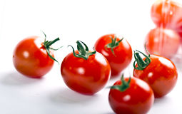 Scattered fresh ripe cherry tomatoes Royalty Free Stock Photo