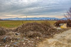 Scattered garbage at a Bulgarian pull-over-area. STARA ZAGORA, BULGARIA - JANUARY 19, 2019: Scattered garbage at a pull-over-area, the town of Stara Zagora, Zora royalty free stock photography
