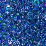 Scattered Gem and Sequin Print with Mermaid Scales. Multicolour sequins and gems create this abstract sparkle background print, with mermaid scales overlay Royalty Free Stock Photo